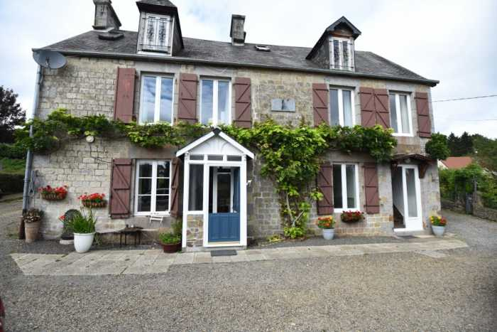 AHIN-SP-001342 Nr Sourdeval 50150 House and gîte with 1563m2 garden on the outskirts of a bustling market town Ideal home and income.