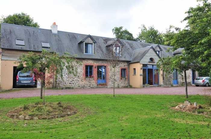 AHIN-SP-0012565 Nr Sourdeval 50150 Completely renovated farmhouse for sale in Normandy - ideal home and income with spacious 6 bed accommodation in attractive landscaped 4041m2 gardens.