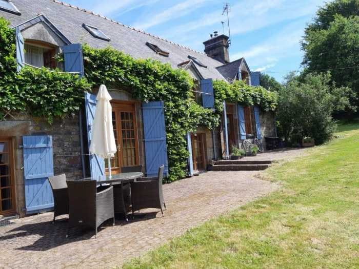 AHIN-SP-001450 Nr Sourdeval 50150 Characterful detached stone house set in over an acre of garden with outbuildings in a quiet rural hamlet.