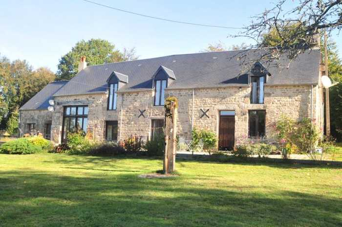 AHIN-SP-001108 Nr Lonlay l'Abbaye 61700 Beautiful detached stone house with attached gîte and over 5 acres.