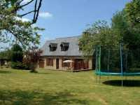 AHIN-SP-001290 Nr Sourdeval 50150 Attractive detached stone house for sale in a quiet rural hamlet in Normandy with 1 acre garden and swimming pool.